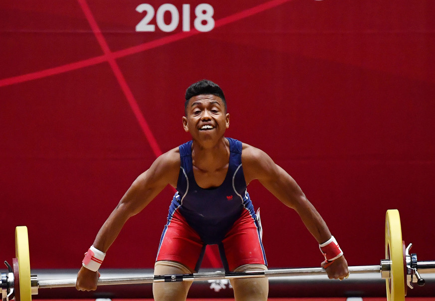 East Timorese lifter Norberto dos Reis Gama performs in the weight class up to 56 kilograms at JiExpo, Jakarta. (Antara Photo/Inasgoc/Fanny Octavianus)