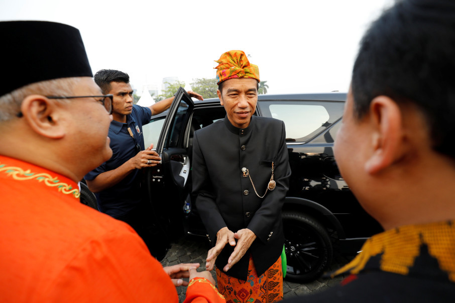 Jokowi arrives at a ceremony. (Reuters Photo/Darren Whiteside)