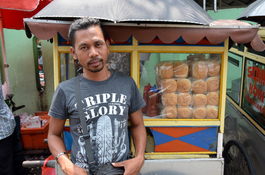Coker in front of his burger stand in East Jakarta. (JG Photo/Cahya Nugraha)