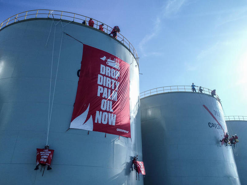 Greenpeace activists protesting on top of a silo at Wilmar International's refinery in Bitung, North Sulawesi, last month. (Photo Courtesy of Greenpeace)