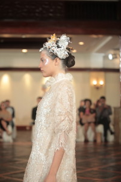 The lightly beaded dress in soft creamy hue that started the fashion show. (Photo courtesy of Studio One)
