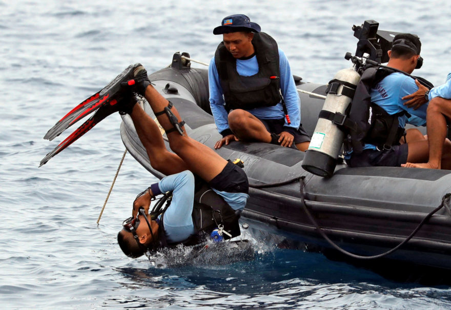 A member of the Indonesian Navy dives at the location of the Lion Air flight JT-610 crash off the north coast of Karawang district, West Java, on Tuesday. (Reuters Photo/Beawiharta)