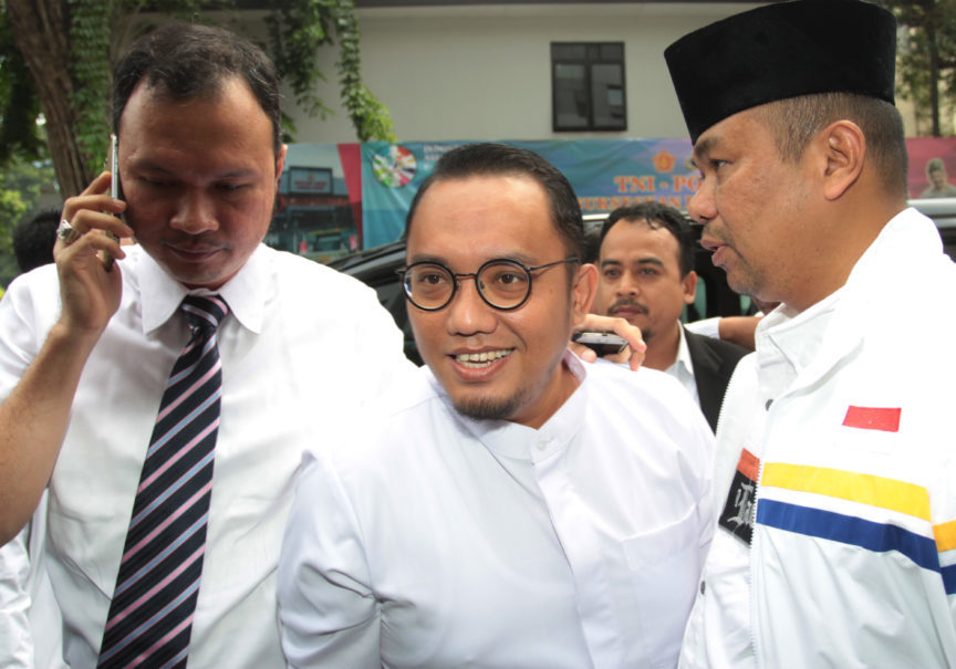 Dahnil Anzar Simanjuntak, center, seen after questioning as a witness in the case against Ratna Sarumpaet in October. (Antara Photo/Reno Esnir)