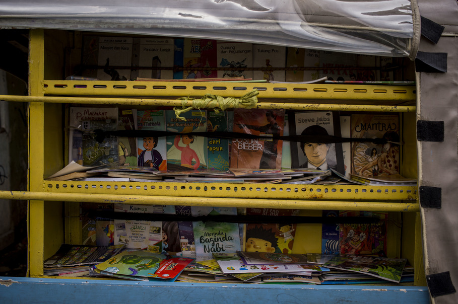 Some of the of educational children's books in Kinong's collection seen inside his mobile library. (JG Photo/Yudha Baskoro)