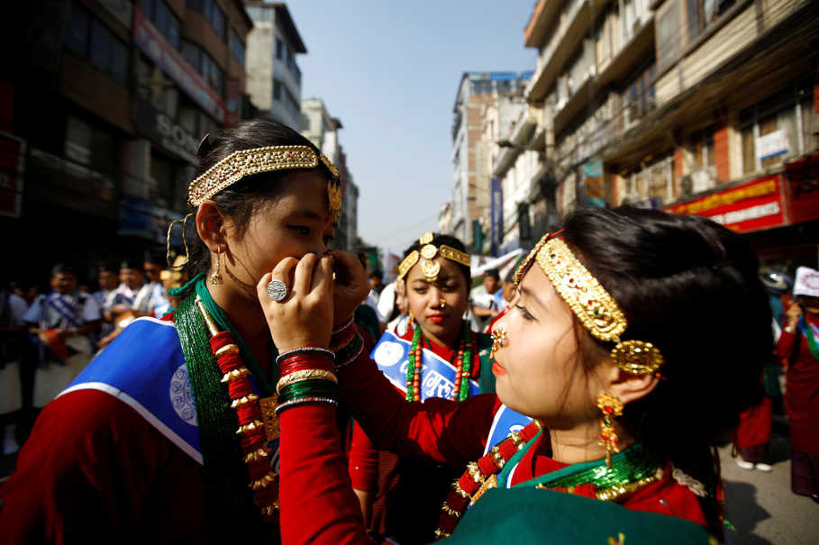 A Gurung girl adjusts her friend's nose ring during a Tamu Lhosar (New Year) parade in Kathmandu, Nepal, on Dec. 30, 2016. (Reuters Photo/Navesh Chitrakar)