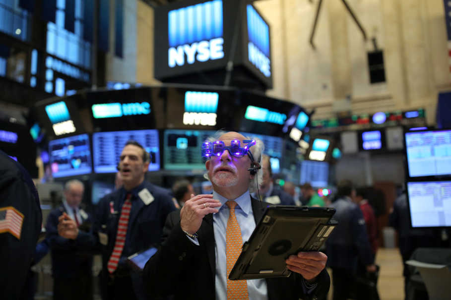A trader wears glasses that say '2017' ahead of the new year on the floor of the New York Stock Exchange (NYSE) in Manhattan, New York, on Dec. 30, 2016. (Reuters Photo/Stephen Yang)