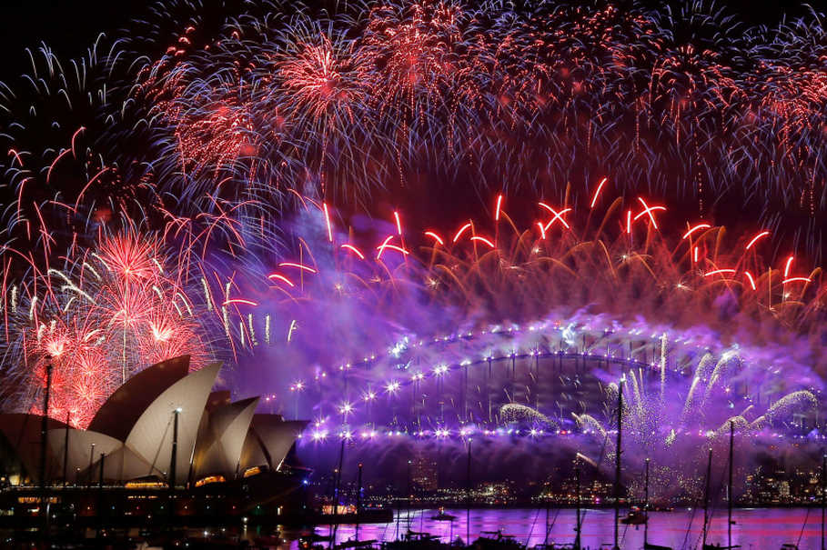 Fireworks explode over the Sydney Opera House and Harbour Bridge as Australia ushers in the New Year in Sydney. (Reuters Photo/Jason Reed)