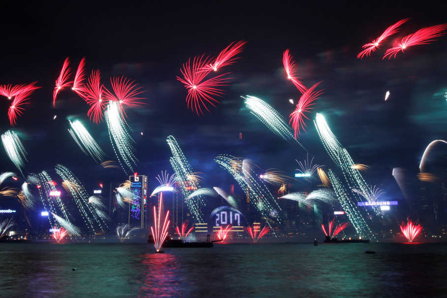 Fireworks at the Hong Kong Convention and Exhibition Center in Hong Kong on Jan. 1, 2017. (Reuters Photo/Bobby Yip)
