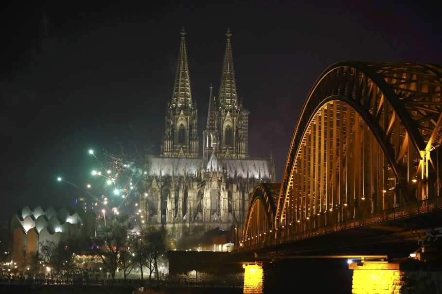 The High Cathedral of Saint Peter in Cologne, Germany, lit up by fireworks on Jan. 1, 2017. (Reuters Photo/Wolfgang Rattay)