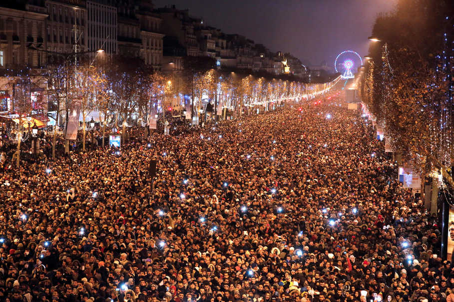 Champs Elysees Avenue in Paris is chockablock with people celebrating New Year's Eve on Dec. 31, 2016. (Reuters Photo/Jacky Naegelen)