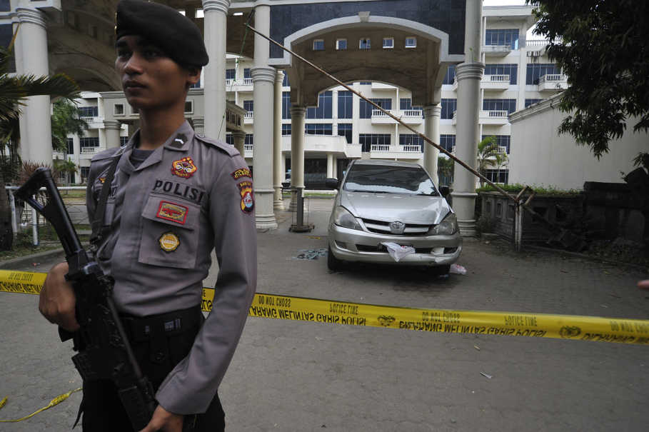 A policeman stands guard in front of the empty Mandalika Hotel in Serang, Banten, after what the police claim to be the 'largest ever' crystal meth seizure inside the hotel. (Antara Photo/Asep Fathulrahman)