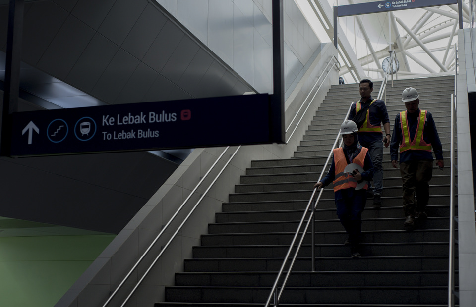 Workers conducts a daily check in Lebak Bulus MRT Jakarta station being prepared to open for public on Tuesday (12/03) (JG Photo/Yudha Baskoro)