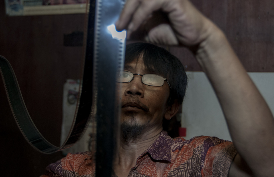 Danny checks his old movie collections at his small studio in Senen, Central Jakarta on Tuesday (26/03) He often sell his collection to movie collectors from India or give it for free to Sinematek Indonesia. (JG Photo/Yudha Baskoro)