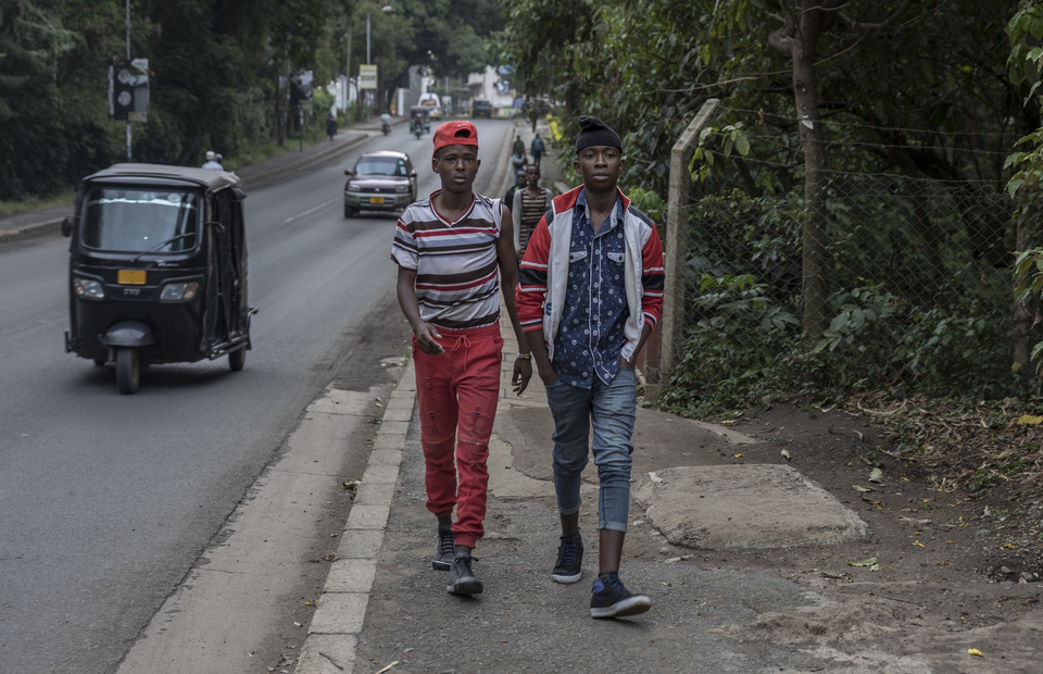 Two teenagers walk on the street near Kibo Pallace hotel in Arusha, Tanzania on Sunday (31/03) Tanzania youth generation love to wear fancy clothes because they begin to promote themself to face country
