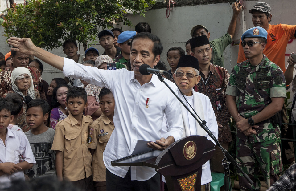 President Joko Widodo gives speeches during his visits in Kampung Deret, Central Jakarta on Tuesday (21/05) (JG Photo/Yudha Baskoro)