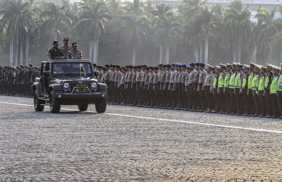 National Police chief Gen. Tito Karnavian and Indonesian Military (TNI) commander Air Chief Marshal Hadi Tjahjanto guarantee the national security during the Idul Fitri (Antara Photo/Rivan Awal Lingga)