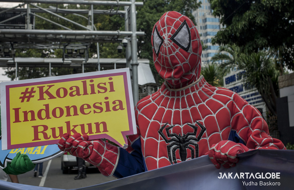 Protester from #Koalisi Indonesia Rukun wearing costume of friendly neighborhood Spiderman march to give support to Constitutional Court to remain neutral (JG Photo/Yudha Baskoro)