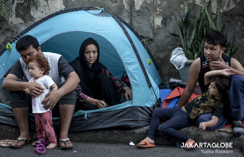 Ali Ahmad and his family member on Tuesday (18/06) One tent was used for five people due to limited space on Jalan Kebon Sirih (JG Photo/Yudha Baskoro)