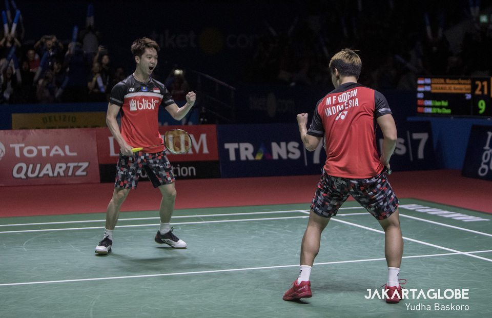 Indonesian men's doubles pair Kevin Sanjaya Sukamuljo and Marcus Fernaldi Gideon celebrate their victory in the semifinal of the 2019 Indonesia Open on Saturday. (JG Photo/Yudha Baskoro)
