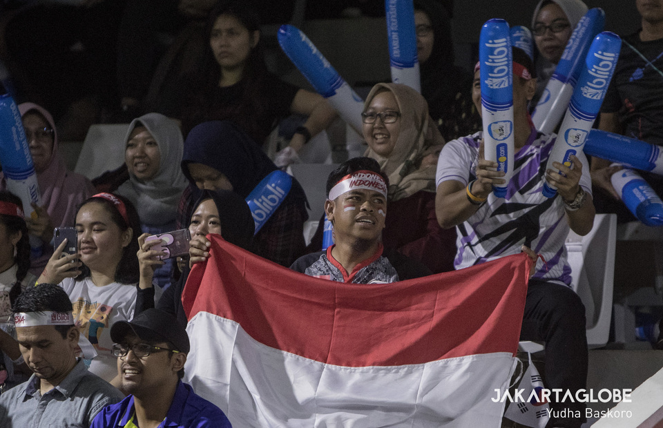 An Indonesian supporter waves the national flag during the 2019 Indonesia Open on Saturday. (JG Photo/Yudha Baskoro)