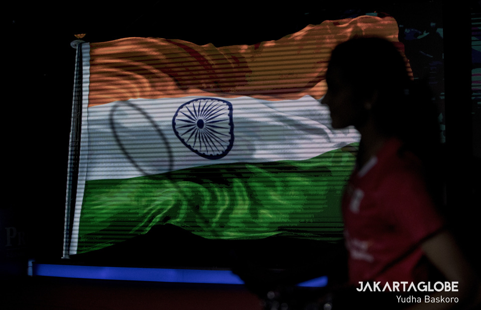 Pusarla Venkata Sindhu of India is silhouetted against an image of her country's national flag as she enters the arena for her semifinal match against Chen Yufei of China. (JG Photo/Yudha Baskoro)