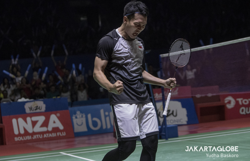 Indonesian men's doubles player Mohammad Ahsan celebrates his and Hendra Setiawan's semifinal victory against Takuro Hoki and Yugo Kobayashi of Japan. (JG Photo/Yudha Baskoro)
