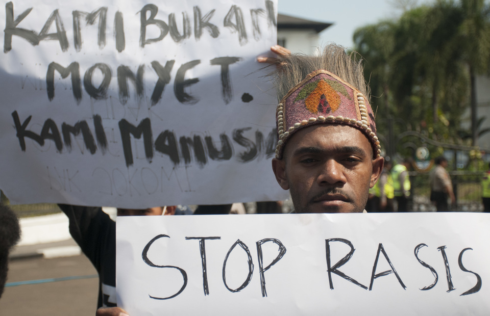 Papuan students in Bandung, West Java, rally in support of fellow students in East Java, who claim that members of an angry mob had called them derogative names. The banners read: 'We are not monkeys, we are human beings' and 'Stop racism.' (Antara Photo/Novrian Arbi).