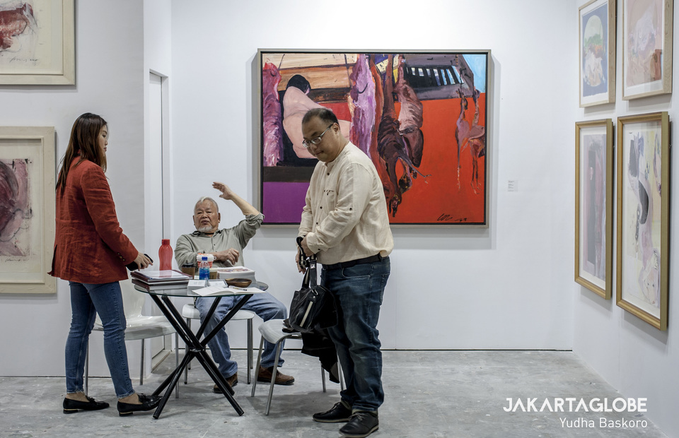 Singaporean painter Wong Keen, center, seen in his 'Flesh Matters' exhibition room. (JG Photo/Yudha Baskoro)