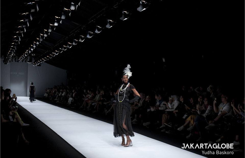 A model walks the runway wearing Rakuten Fashion Week Tokyo