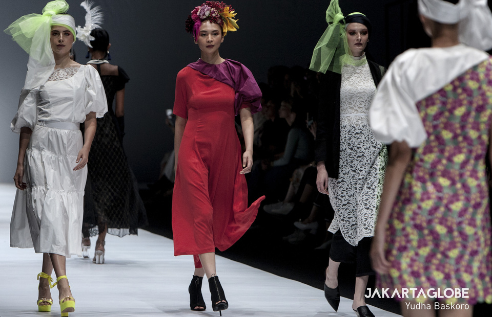 Models present a creation from Japanese Rieka Inoue during 2020 Jakarta Fashion Week at Senayan City Mall in Central Jakarta on Tuesday (22/10). Rieka Inoue open the fashion show with her newest collection tittled: