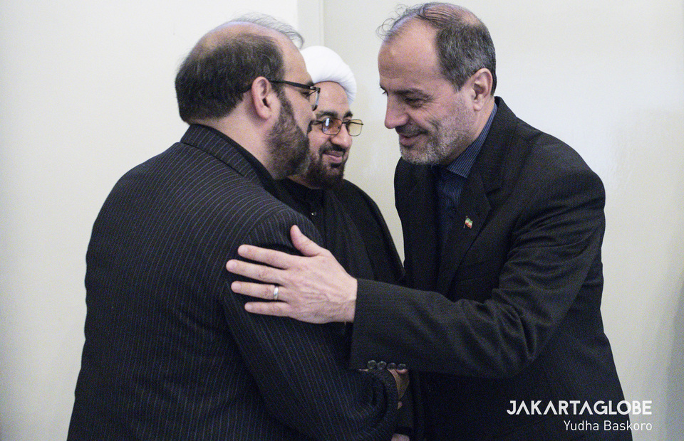 Iran Cultural Center representative hug Iran Ambassador to Indonesia Mohammad Azad