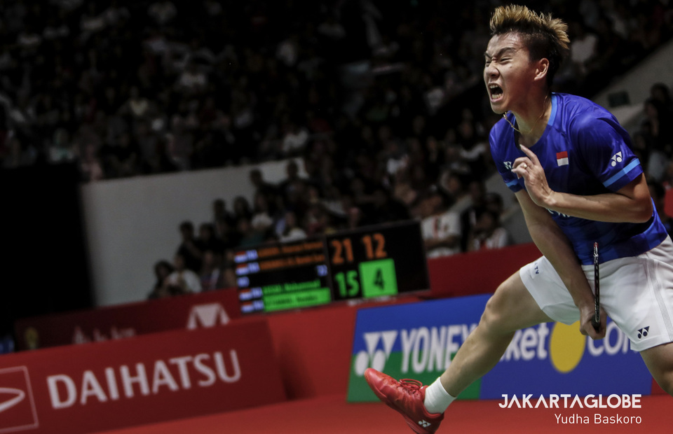 Marcus Fernaldi Gideon jumps for smash during Indonesia Masters 2020 final match. (JG Photo/Yudha Baskoro)