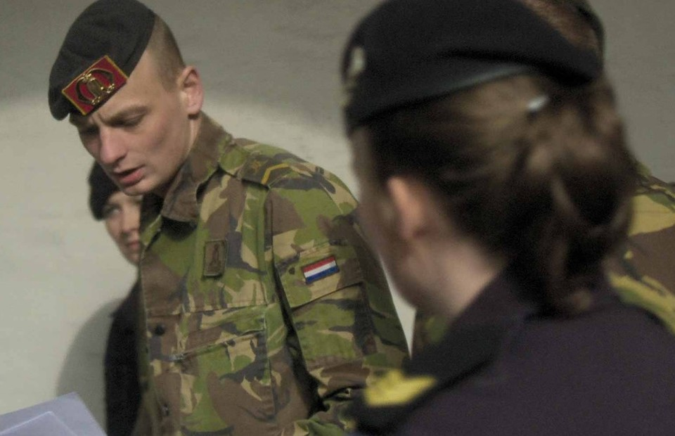 The cadets of Royal Netherlands Army reading a transcript. (Photo courtesy of the artist)