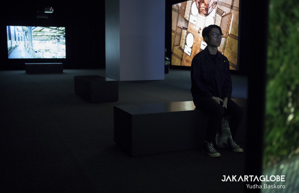 A man watches Julian Rosefeldt: Manifesto in Museum Macan, West Jakarta on Wednesday (26/02). (JG Photo/Yudha Baskoro)