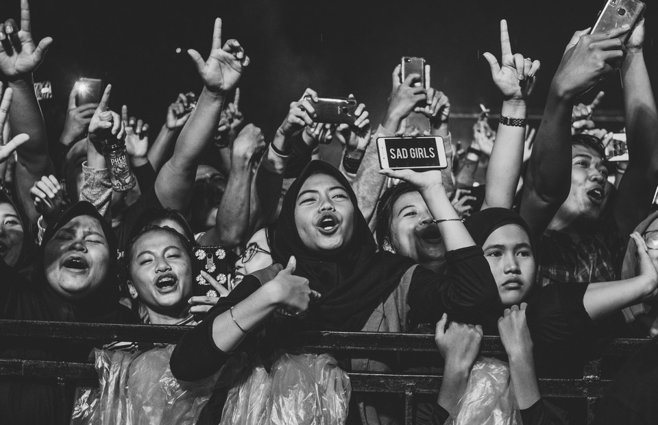 A fans shows a sad girl sign during the lord of broken heart concert in Tangerang