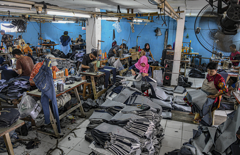 Textile workers in a jeans production industry in Jakarta