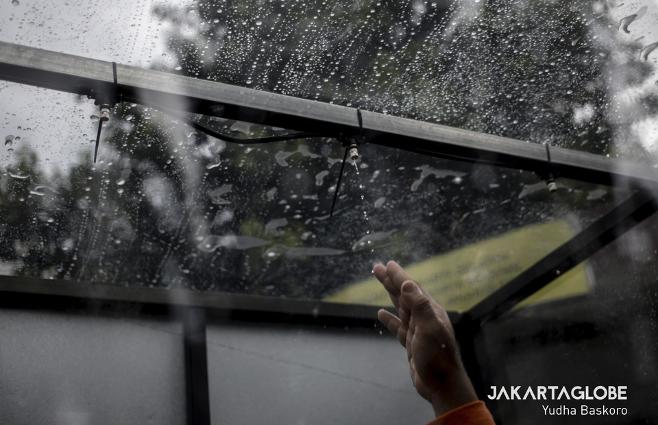 A worker tests disinfection chambers shower. (JG Photo/Yudha Baskoro)