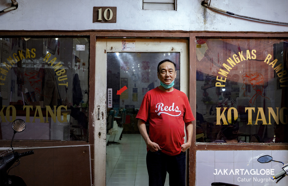 Pi Cis, the owner of Ko Tang Barbershop, stands in front of his stall in Glodok, West Jakarta. (JG Photo/Catur Nugroho)