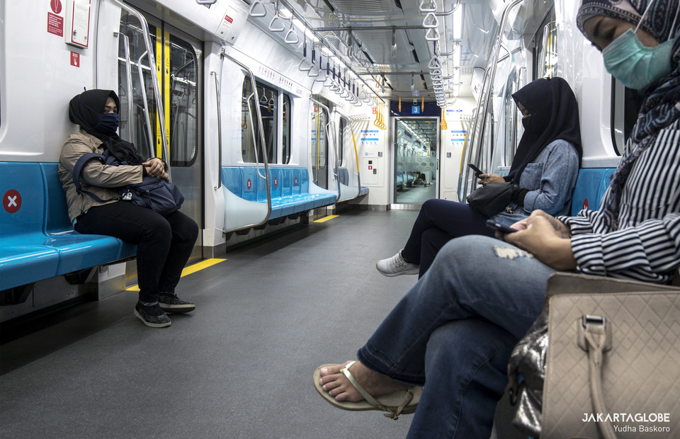 MRT passengers sit with PSBB health protocol to prevent the spread of coronavirus disease (Covid-19). (JG Photo/Yudha Baskoro)