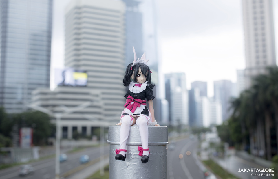Nico, Yohanes waifu sits with Jakarta view as background. (JG Photo/Yudha Baskoro)