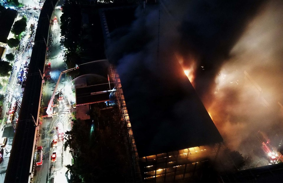 An aerial view of the massive flames that destroy the north wing of a main building at the Attorney General s Office compound in South Jakarta on August 22, 2020. (Beritasatu Photo/Joanito De Saojoao)