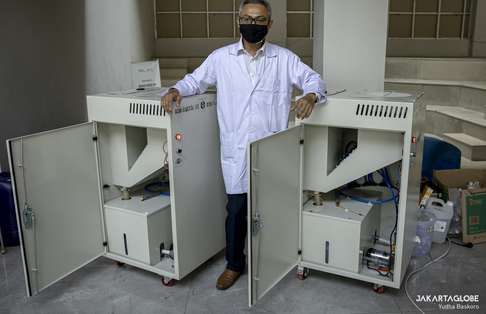 LIPI researcher Nurul Taufiqu Rochman poses with ATTACT machine, COVID-19 air purifier at LIPI