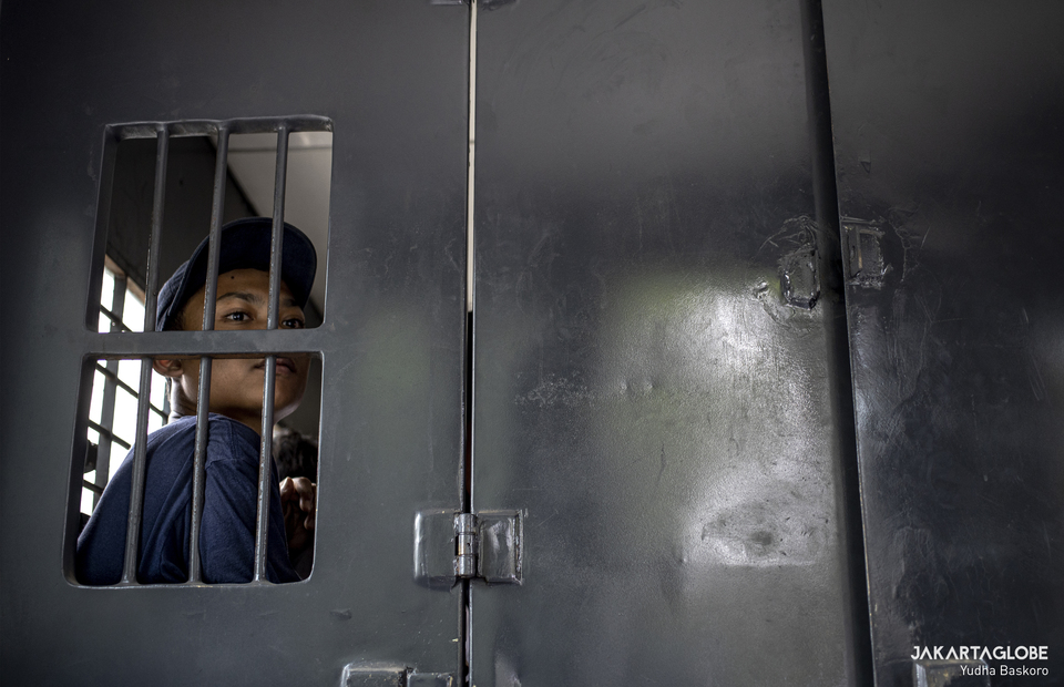 A student is seen inside a detention car behind the national legislative complex in Senayan, Central Jakarta on Wednesday (07/10).