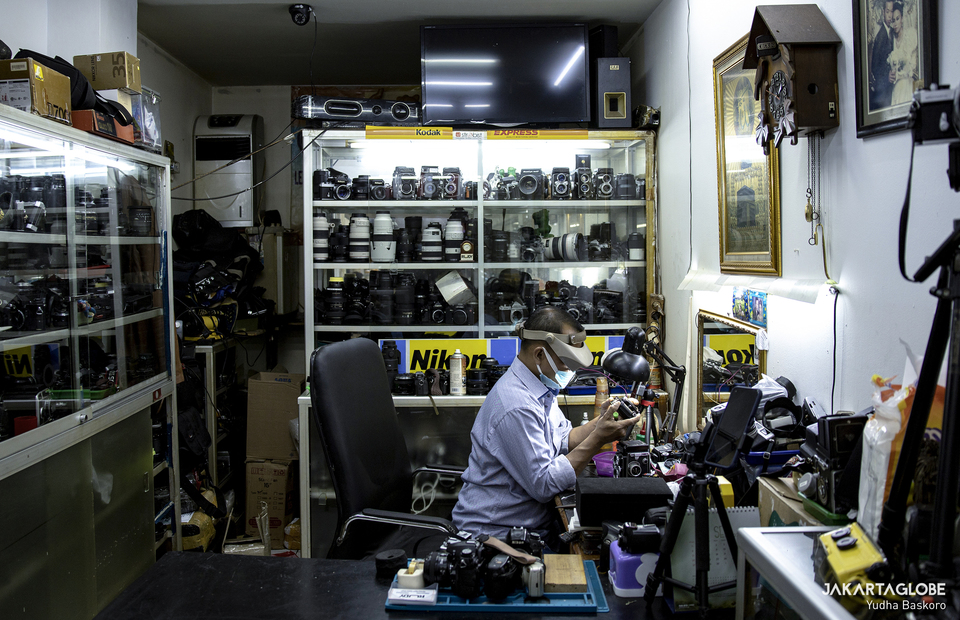Rudy sits in his work station inside in Harco building in Pasar Baru area in Central Jakarta. (JG Photo/Yudha Baskoro)