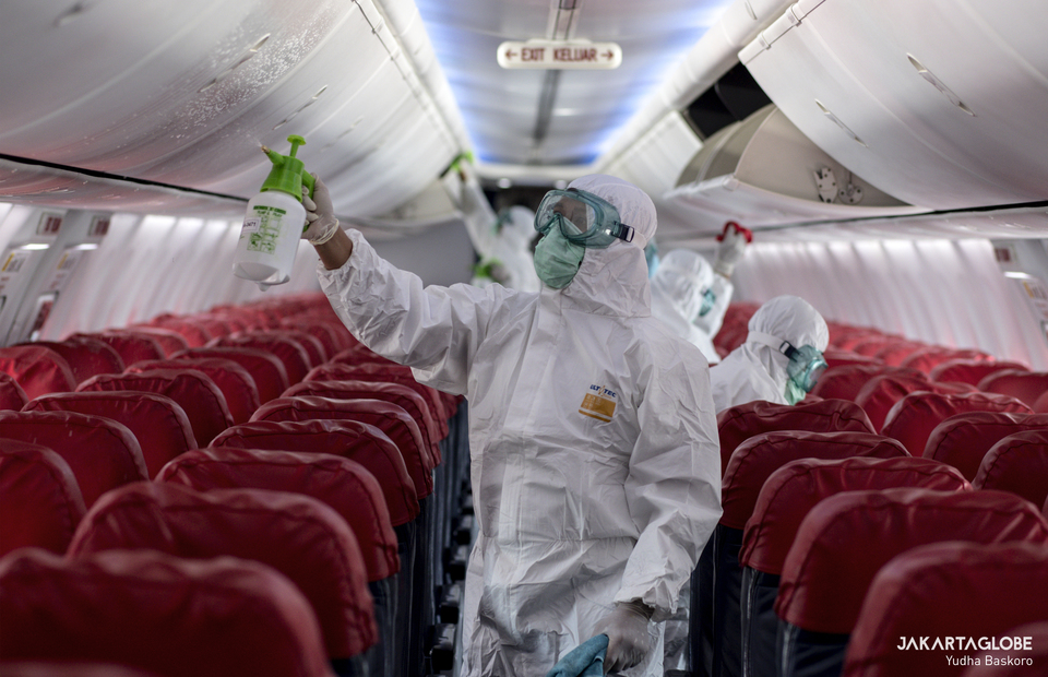 Airport Health Authorities officers disinfect a Lion Air Boeing 737-800 at Soekarno-Hatta International Airport. on March 17, 2020. (JG Photo/Yudha Baskoro)