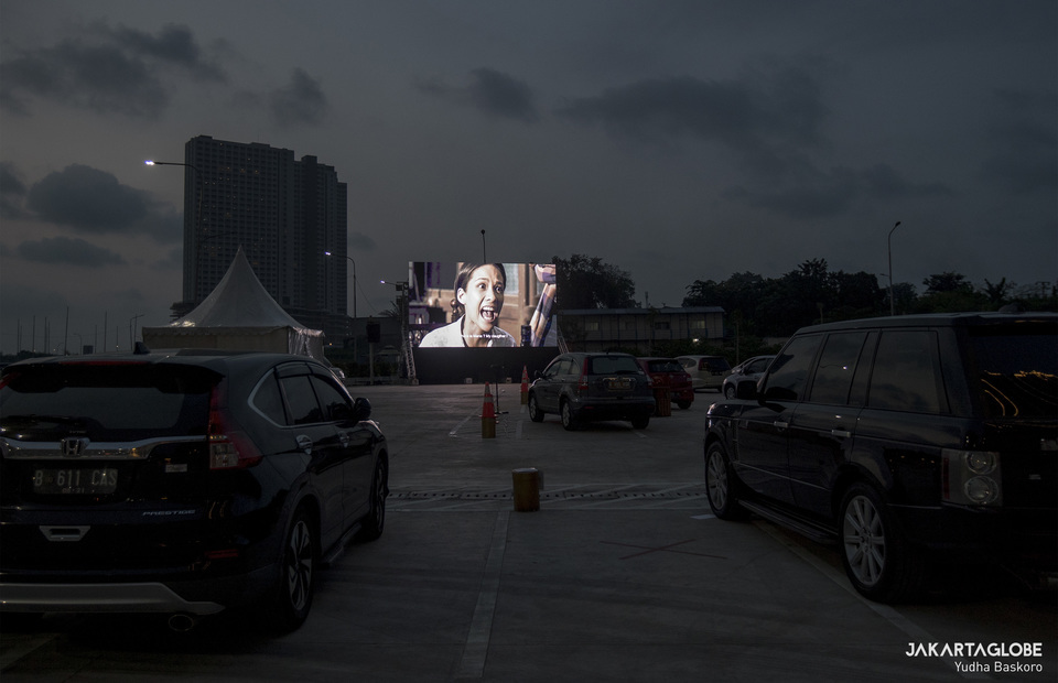 Drive-in diners watch a movie at a parking lot in the Meikarta integrated residential complex in Cikarang, West Java, on June 3, 2020. (JG Photo/Yudha Baskoro)