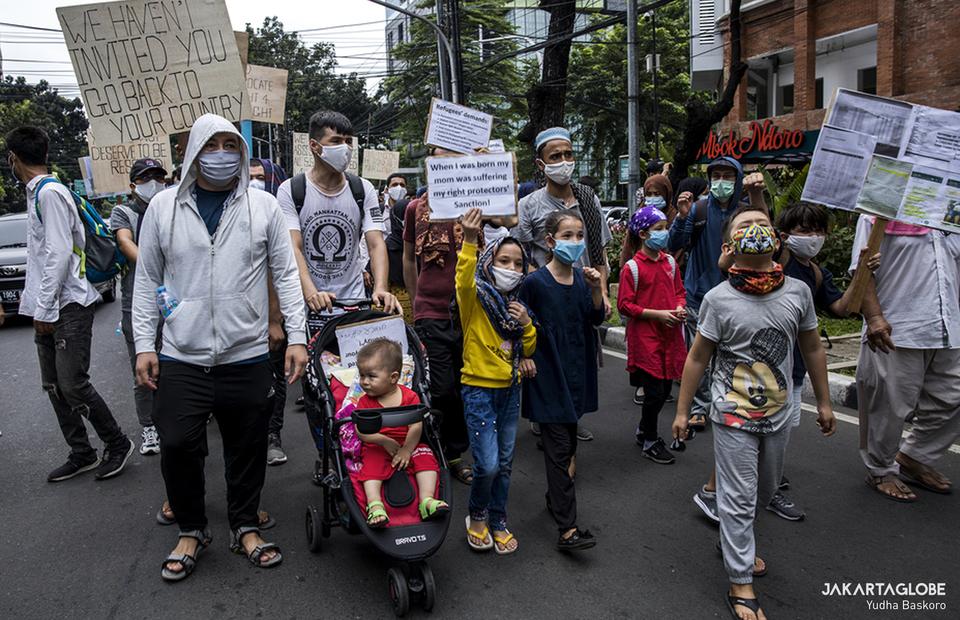 Refugees stage a rally in front of UNHCR office in Kebon Sirih, Central Jakarta on July 14, 2020. (JG Photo/Yudha Baskoro)