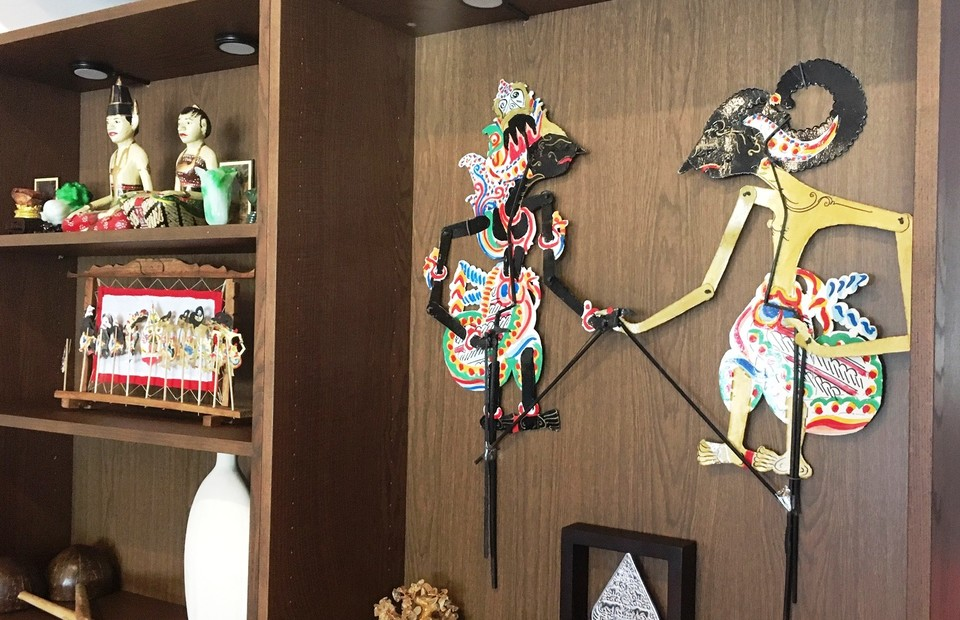 The Javanese puppet characters of Bima, right, and Krisna on display in Monggo restaurant on January 19, 2021. (JG Photo/Meleva Thorn)