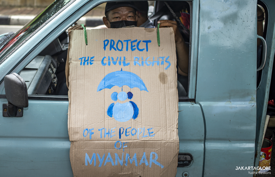 Protester carry placard during protest in front of Myanmar Embassy in Central Jakarta on Feb, 5, 2021. (JG Photo/Yudha Baskoro)