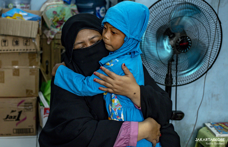 Desi hugs her student after class at Rumah Belajar Merah Putih in Kojem, North Jakarta on Feb 19, 2021. (JG Photo/Yudha Baskoro)